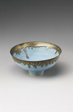 Lucie Rie: Footed bowl, Stoneware, barium blue glaze, golden manganese glaze. 8 1/4 in. (21 cm.) diameter, c.1980