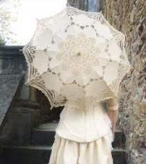 Lace umbrella. Visit prettyasapicture.ie, an award winning wedding invitation and gift boutique based in Ireland, who offer a complete custom design service for letterpress wedding invitations and personalised stationery.