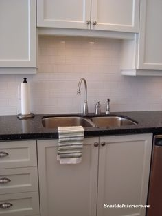 subway tile, black countertop, white cabinets... I really like that.