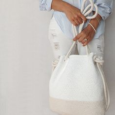 Easy crochet pattern for the perfect summer purse or beach bag … complete with crochet rope! This pattern creates two sizes so mother – daughter or grandmother – granddaughter can match on their next shopping adventure or trip to the ocean.