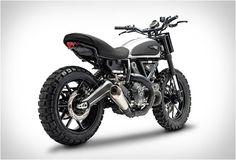 Como a impressionante 2015 Ducati Scrambler começa a rolar em salas de exposição, muitos construtores personalizados estão esfregando as mãos com entusiasmo por uma chance de personalizar a moto, destinado a se tornar uma moto favorita para pers