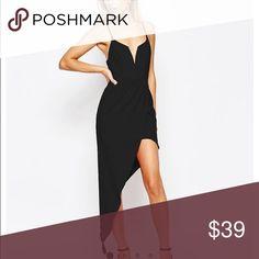 Black Asymmetrical dress NWT. size 2 Sexy black asymmetrical dress. NWT didn't fit quite right on my torso and got lazy about returning.  ASOS Dresses Asymmetrical