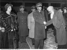 Pahlavi Mohammad Reza Shah and Queen Sorayya are greeted by a senior Sikh member of the Indian community.