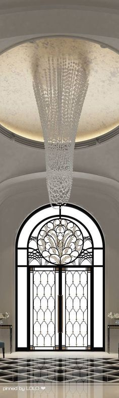 THE ORNATE ARCHED DOUBLE FRENCH DOOR MAKES A STATEMENT AS GUESTS ENTER YOUR HOME AND THE BREATHTAKING SUMPTUOUS CRYSTAL CHANDELIER AND FABULOUS CEILING ARE A MAJOR WOW FACTOR IN THIS STUNNING FOYER.CHERIE