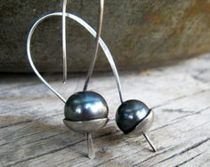 Black pearls cradled in sterling silver.  TheSilverPearl has gorgeous earrings!!! Etsy.... $45