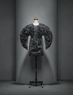 Iris Van Herpen (Dutch, born 1984). Dress, autumn/winter 2013–14, Haute Couture. Machine–sewn black cotton twill, hand–painted with gray and purple polyurethane resin and iron filings, hand–sculpted with magnets. Photo © Nicholas Alan Cope. #ManusxMachina #CostumeInstitute