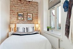 White wall bedroom ideas exposed brick tiny apartment renovation featuring walls red black and paint Brick Wall Bedroom, White Wall Bedroom, Narrow Bedroom, Bedroom Decor, White Walls, Bedroom Ideas, Wall Decor, Brick Walls, Bedroom Inspiration