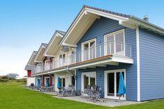 Klare Linien und ein schönes Design: Skandinavische Ferienhäuser mit Sauna und Kamin - in Toplage direkt hinter dem Deich am Nationalpark Wattenmeer.