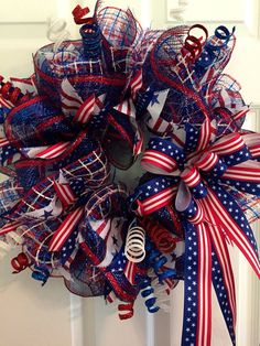 This wreath pops with red white and blue color. Show your patriotic pride on the Fourth of July, Memorial Day, Veterans Day, Presidents Day, Labor Day or anytime of the year. I used navy and red premium metallic deco mesh and red white and blue basket weave deco mesh to make this wreath.