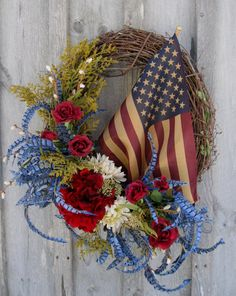 """Americana Wreath with Tea Stained Flag - Silk meadow grass and flora in navy, denim blue, deep cranberry, soft ivory and soft meadow green on a grapevine frame.  26"""" diameter, 10"""" depth.:  Darlene Provitola, New England Wreath, Maine, Etsy"""