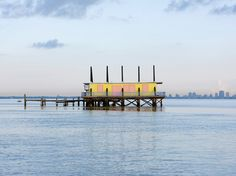 """These """"floating houses,"""" situated in Miami's Biscayne Bay on the northernmost reaches of the Keys, first popped up in the 1930's. They've served as everything from fishing campouts to illegal bars to uninhabited relics, but have retained a mysterious allure from the beginning. Nowadays, you need a permit to visit (the place is a protected area), but they can still be seen at a distance if you're sailing by."""