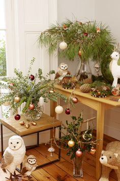 Take to the hills for a cosy Christmas inspired by the rugged landscape of the Highlands. Bring the outdoors in, by adorning fresh greenery with metallic baubles for an alternative Christmas tree perfect for small spaces.