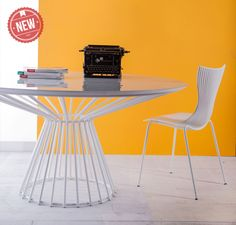 Carlisle Round Dining Table features painted spoke base and available in white or black painted steel base with colored glass or wood table top.