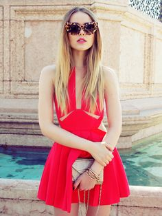 For an edgier and more contemporary style, try wearing a cut away red dress like Kristina Bazan. This look is sexy and summery, a winning combination! Dress: Three Floor, Clutch/Shoes: Jimmy Choo.