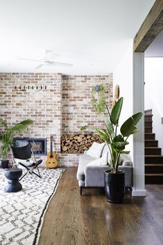 Add oversized greenery to a rustic space. | 25 Absoluely Gorgeous Living Room Decor Ideas | StyleCaster