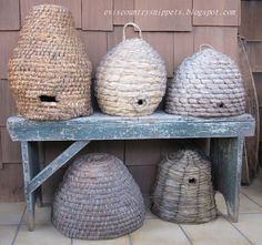 These bee skeps are made like those in the colonial days out of grass.  Not  practical but very beautiful!