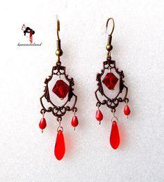 Pendientes burlesque rojos con tupis y lágrimas de cristal.