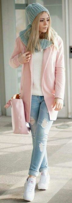 Pink pea coat, white sweater, matching blue scarf and hat, and of course distressed jeans!