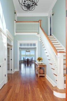 Imagine walking through your front door and looking down that hall to that view.House of Turquoise: Jacob Talbot Fine Homebuilders House Of Turquoise, Turquoise Accents, Turquoise Room, Room Colors, Wall Colors, Accent Colors, Colours, Benjamin Moore Beach Glass, Palladian Blue Benjamin Moore