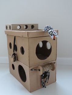 inexpensive cat playhouse DIY. Tunnels, circles GLEE:) #cats #CatMakings #CatCondos