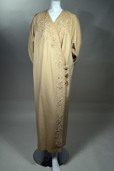 1910s FRENCH TAN WOOL FLANNEL COAT WITH ELABORATE CORD WORK AND EMBROIDERED FLORAL TRIM - DEVEREUX, Paris.  Available for sale at rpvintage.com.