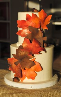 The Sugar Suite is proud to introduce our Thanksgiving Cake Centerpieces! Edible sugar fall leaves and acorns garnish this spice cake and p. Sweet Cakes, Cute Cakes, Pretty Cakes, Beautiful Cakes, Awesome Cakes, Holiday Cakes, Holiday Desserts, Cake Centerpieces, Thanksgiving Cakes