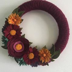 Felt flower wreath in jewel tones. The photo is really dark because its really cloudy here today but its sooooooo much prettier in person :)