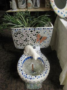 I realize this has been converted to a planter and fountain, but but I'm thinking the mosiac thing might be cute for a toilet that is still in your bathroom