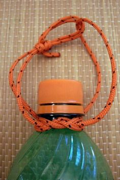 Make your own paracord survival bracelet in case of emergencies.How to tie anything and everything. make your beverage easy to schlep on longer hikes with a DIY water bottle carrying strap.How to tie a jug knot --- maybe a way to carry my gatorade bo Paracord Knots, Water Bottle Holders, Water Bottles, Soda Bottles, Paracord Projects, Cub Scouts, Tie Knots, Survival Skills, Survival Prepping