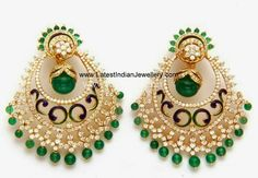 The gorgeous diamond chand bali earrings edged with emeralds and decorated with meenakari enamel work.
