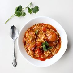 Celebrate Mardi Gras with this one pot, done in one hour jambalaya. Click to learn the secrets to making this dish authentic!