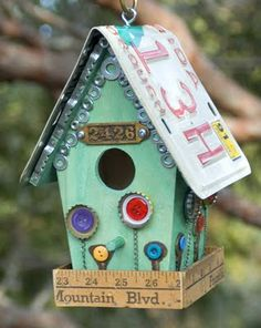 love the idea of using old bottle caps and an old ruler to enhance this birdhouse