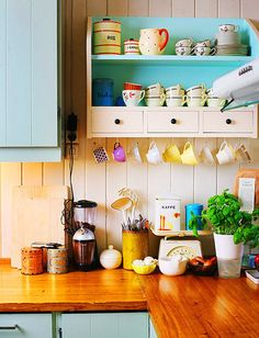 I love the idea of hanging mugs. You can switch out the mugs for special occasions to add some punch to your kitchen or bar area.