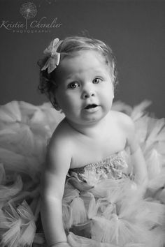 Black and white child photography using natural lighting from a window