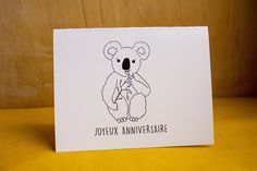 x french birthday card with blank interior to write your own message. Can be used for birthdays. Package includes one greeting card and an enveloppe. Back of card has Lily au bois dormant logo and website. Black laser print on 250 gsm white paper. Baby Koala, Birthday Cards, Birthdays, Stationery, Greeting Cards, Lily, Messages, French, Black And White