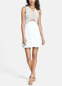 On trend! Love this white mesh cut-out dress for spring.