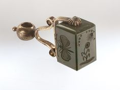 Gilt metal swivel mounted fob seal set with a bloodstone. The bloodstone is engraved with: 1) a butterfly, 2) a flower turning towards the sun, 'A vous seul', 3) 'L'amitie est l'amour sans ailes'. Engraved on the setting are the initials 'EH' and 'HN', this suggests that the seal might be associated with Vice-Admiral Horatio Nelson (1758-1805) and Emma, Lady Hamilton (circa 1765-1815).