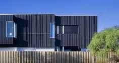 Dark timber look external cladding on Contemporary beach house.