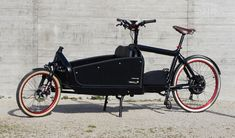 Bullit cargo bike with front suspension, integrated lighting, blacked out bionx assist.