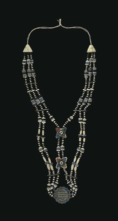 A BACTRIAN STONE AND SHELL BEAD NECKLACE CIRCA LATE 3RD MILLENNIUM B.C.