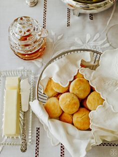 Biscuits served on white linen and silver