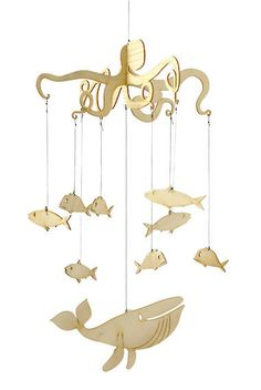 A wooden mobile to hang above the crib/changing table. My hubby is going to make some wooden cutouts of Peter Pan themed silhouettes, such as a pirate ship to hang at the base, a cloud for the top, and then little figures for the middle - either characters or items from the movie, like a sword, feather, teddy bear, etc..