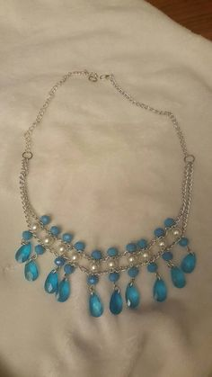 Check out this item in my Etsy shop https://www.etsy.com/listing/484638409/white-and-bleu-bead-necklace