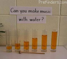 Using  glass vases from the craft store and  different amounts of colored water , the children can use a guiro mallet to gently tap them as they listen to the musical notes made.Display explores water and sound.