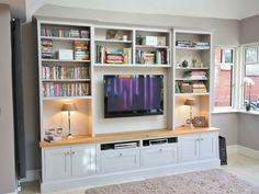 Bespoke TV Unit with natural oak veneer top.