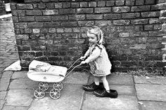 picture by Shirley Baker, from the Mary Evans Picture Library (taken around Manchester in the sixties) from vintage photo I quite like her photos of children at play in the streets. Vintage Pictures, Vintage Images, Shirley Baker, Goldscheider, Vintage Illustration, Dolls Prams, Photo Vintage, Dad Shoes, Shoes Too Big