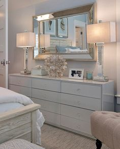 Home decorating ideas - bedroom dresser style with double mirrored lamps, capiz shell table lamp and soft blues |  Asher Associates Architects, Megan Gorelick Interiors