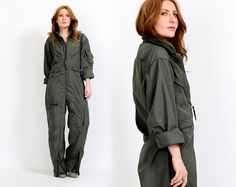 Vintage 80s authentic military flight coveralls jumpsuit. Army green with a metal zipper up the front, adjustable tabs at the waist, lots of zippered pockets, and zippers at the ankles. EXCELLENT condition. https://www.etsy.com/listing/189893426/vintage-army-jumpsuit-military-flight?utm_source=Pinterest&utm_medium=PageTools&utm_campaign=Share