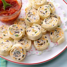 Appetizer Tortilla Pinwheels Recipe -A friend gave me this recipe, and whenever I serve these pretty and delicious appetizers, people ask me for the recipe, too! Besides being attractive and tasty, the pinwheels can be made ahead of time and sliced just before serving, leaving you time for other last-minute party preparations. —Pat Waymire, Yellow Springs, Ohio
