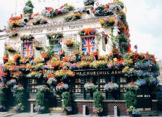 The Churchill Arms, a traditional, though brightly decorated, London pub...with...a secret, authentic, Thai restaurant hidden in the backyard!